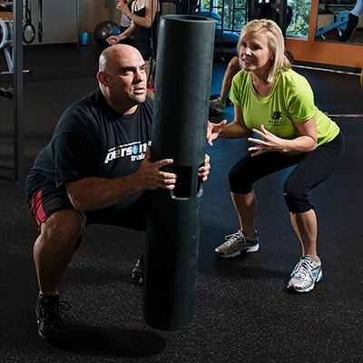 Cal Fit Member Working Out with Body Fit Coach