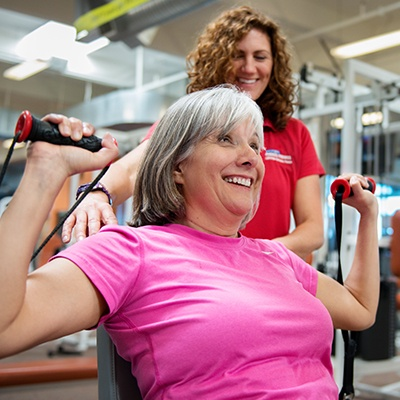 woman working with sacramento gym personal trainer