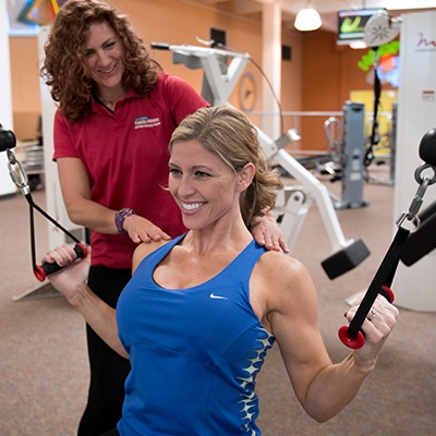 woman working out with personal trainer Sacramento