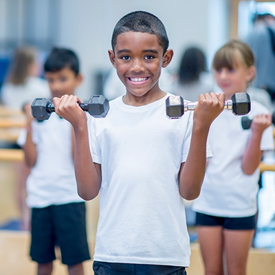 child in kids fitness program