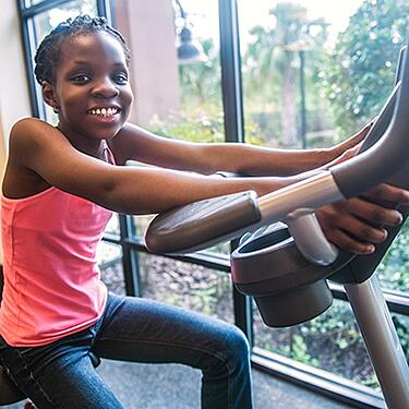 Young Girl Working Out at the Gym
