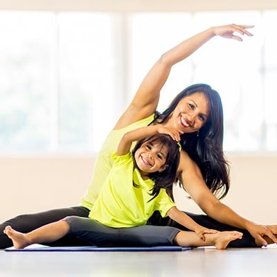 Mother and child doing family yoga class