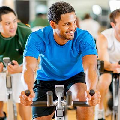 man enjoying cal fit indoor cycling class