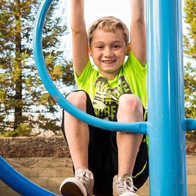 boy playing at gym with kids club