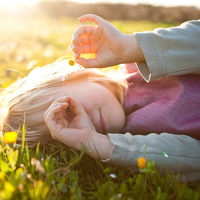girl playing outside in grass