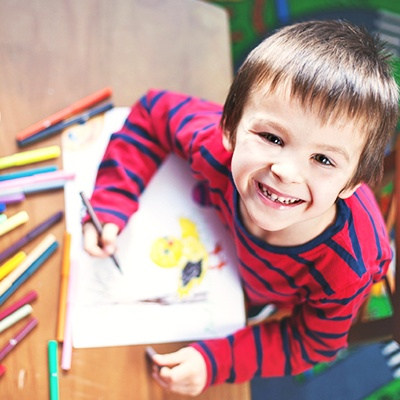 boy coloring at gym with childcare in Sacramento