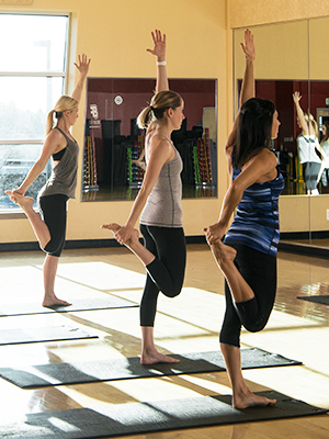 Women in yoga class holding a pose