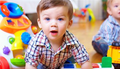 Baby playing at Sacramento gym with childcare.