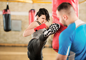 woman cardio kickboxing at the gym