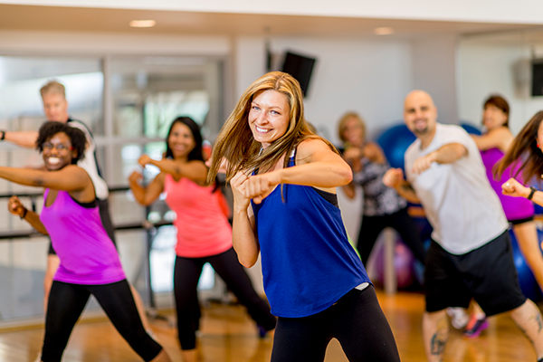 people in gym cardio kickboxing class