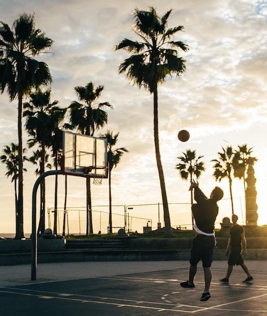 people playing at gym with outdoor basketball court