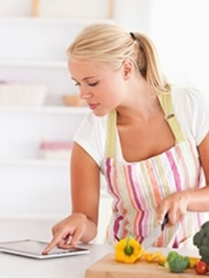 woman following recipe from fitness blog