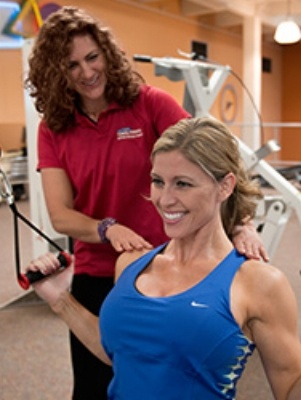 cal fit personal trainer with gym member