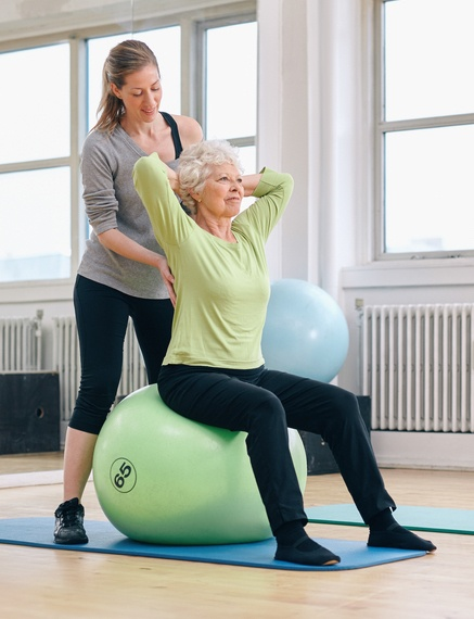 senior with personal trainer