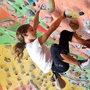 child using indoor climbing wall at sacramento gym